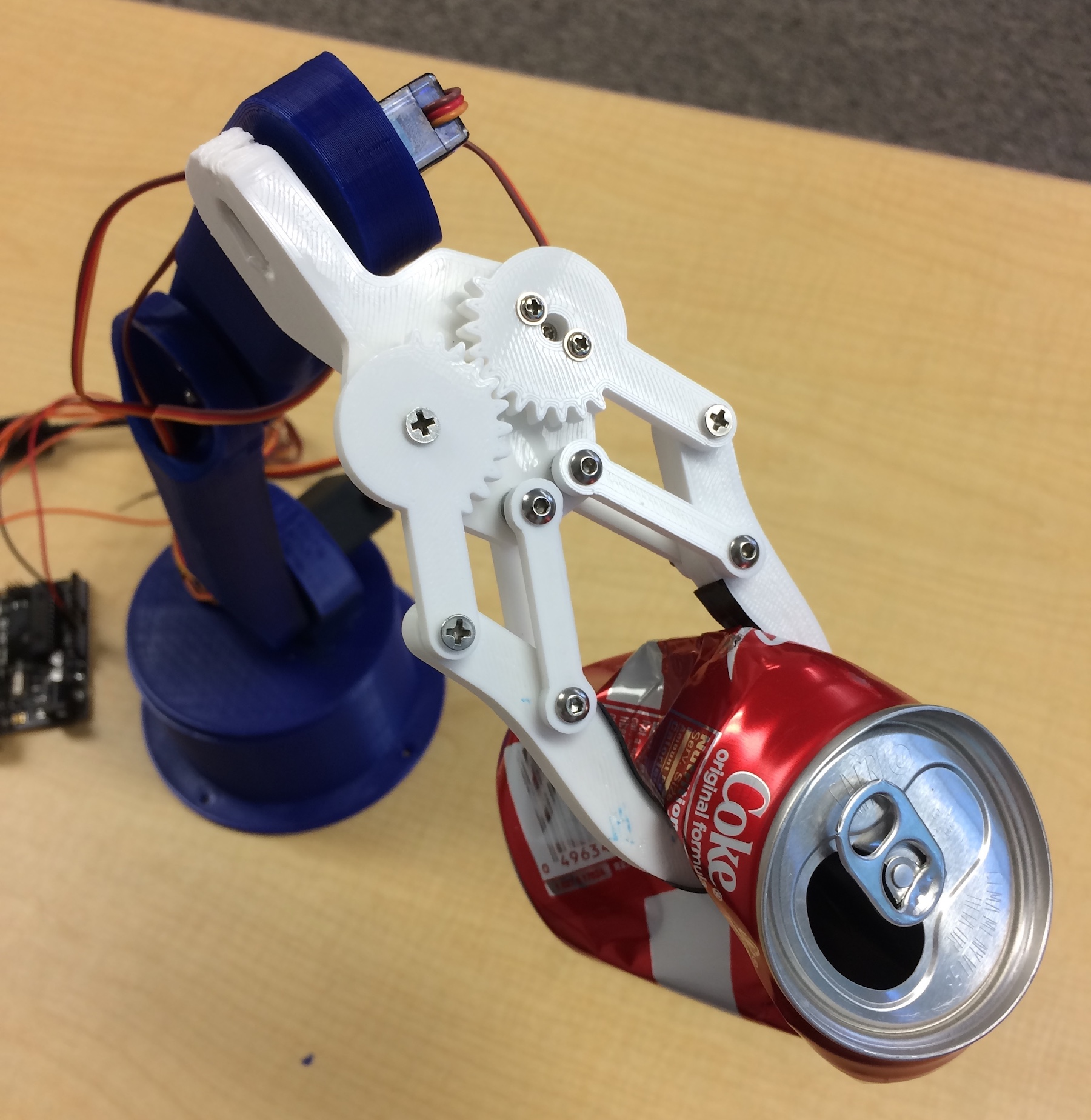 robotic arm with soda can Andrew Bernas
